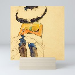 "Egon Schiele ""Seated semi-nude with hat and purple stockings"" Mini Art Print"