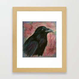 Raven rising against a pink sunset Framed Art Print