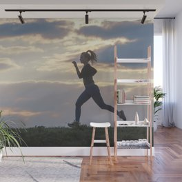 Running woman morning workout. Female Runner. Jogging during sunrise. Workout in a Park. Sporty Wall Mural
