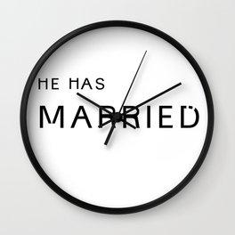 he's married. Wall Clock