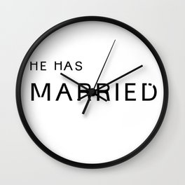 he's married. Wall Clock