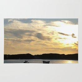 Sunset over Lancashire sea fishing boats  Rug