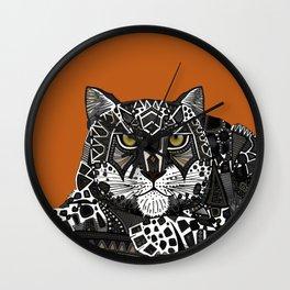 snow leopard orange Wall Clock