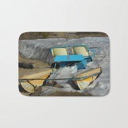 Sea holidays concept. Catamaran standing on snow. Bath Mat