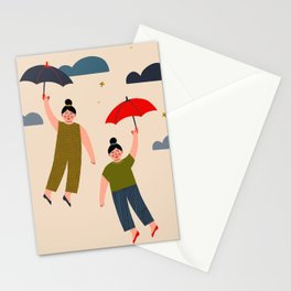 Girls flying with umbrellas Stationery Cards