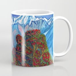 Blooming tree on a background of snowy mountains Coffee Mug
