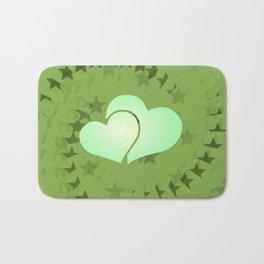 Two green hearts illusion Bath Mat