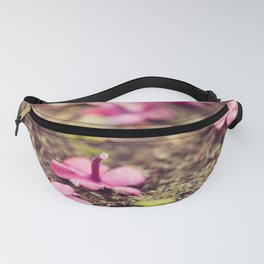 Vivid purple flowers on the ground Fanny Pack