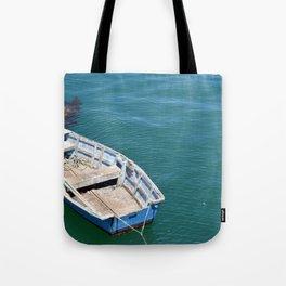 Boat in sea Tote Bag