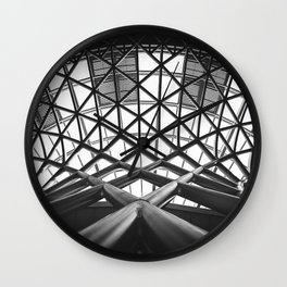 Low angle photography of metal building on grayscale Wall Clock