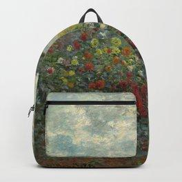 Claude Monet  A Corner of the Garden with Dahlias Backpack