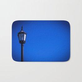 lamp over blue sky Bath Mat