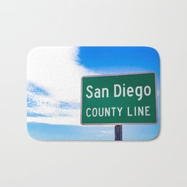 Closeup of the San Diego County Line Sign against a Blue Sky in the Anza Borrego Desert State Park Bath Mat