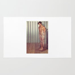 Sexy naked man wrapped with pallet wrap in a industrial container Rug