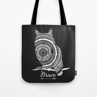 be brave Tote Bags featuring brave by Vickn