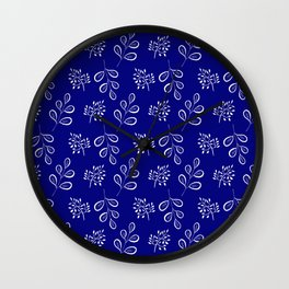 White laves on a deep blue Wall Clock