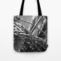 the wire Tote Bags featuring Barbed Wire by Fine2art