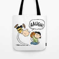 charlie brown Tote Bags featuring Charlie Brown Foot Ball by PSimages