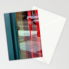 Two Windows - Red Drapes Behind Stationery Cards