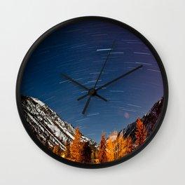 snowy mountaintops beneath the stars Wall Clock