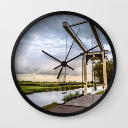 Canal and Bridge in Netherlands at Sunset Wall Clock