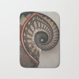 Spiral staircase in pastel brown tones Bath Mat