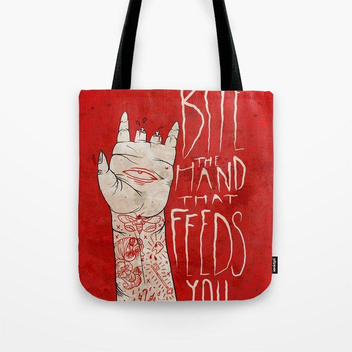 bite the hand. Tote Bag