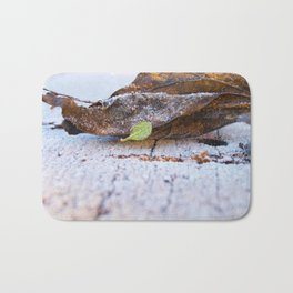 Frosted leaves on the snowy table. Bath Mat