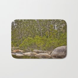 Peaceful river view with rocks Bath Mat