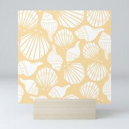 Sea shells on yellow Mini Art Print