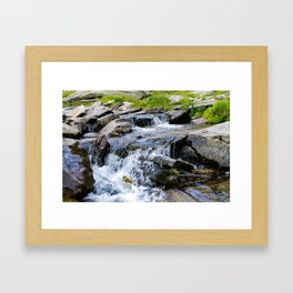 A small waterfall in the water stream. Framed Art Print