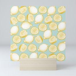 Lemons On Turquoise Background Mini Art Print