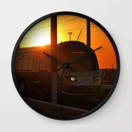 Train at sunset Wall Clock