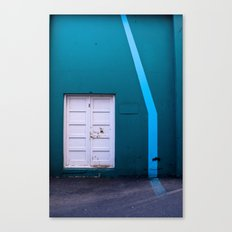 White Door Blue Wall Canvas Print