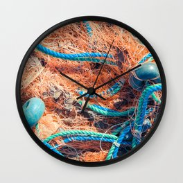 Crumpled fishnet with buoys on rope Wall Clock