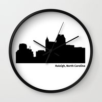 north carolina Wall Clocks featuring Ralleigh, North Carolina by Fabian Bross
