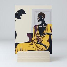 Yellow robe Mini Art Print