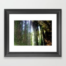 Vines camouflaging a sunken Cave Framed Art Print