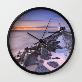 The lighthouse of Marken in The Netherlands at sunrise Wall Clock