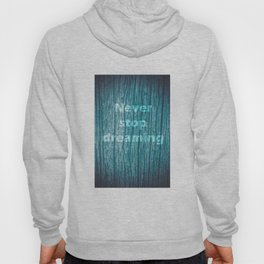 Old piece of wood painted blue with the phrase never stop dreaming Hoody