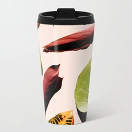 Different leaves laying over a pink background Metal Travel Mug