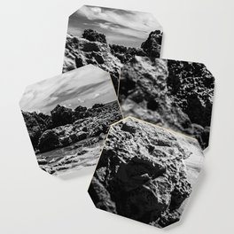 Landscape of sea rocks and sand. Coaster