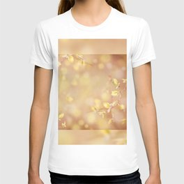 Many young spring leaves on blurred background T-shirt