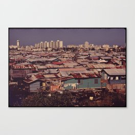 'MODERN BUILDINGS TOWER OVER THE SHANTIES CROWDED ALONG THE MARTIN PENA CANAL' Canvas Print