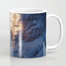 Midday sun on snow covered winter spruce trees Coffee Mug