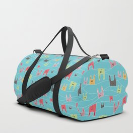 Colorful bunnies on blue background Duffle Bag