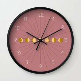 Moon Phases in gold with a starburst and dusty rose background Wall Clock