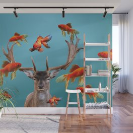 Deer with goldfishes swimming around Wall Mural
