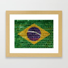 Brazil flag on a brick wall Framed Art Print