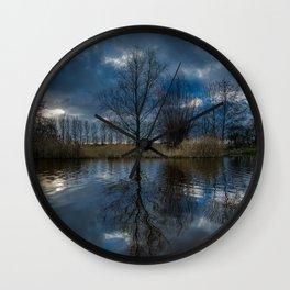 Winter tree reflection Wall Clock